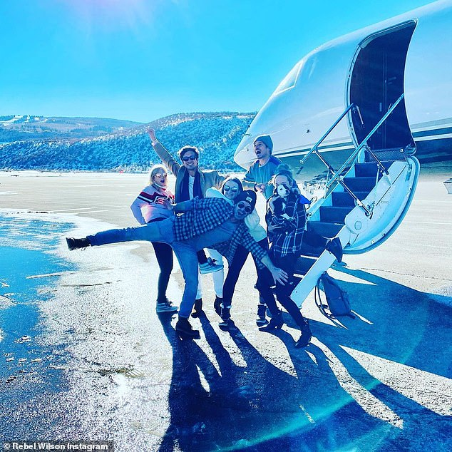 Vacation crew: The loved-up couple were joined by four of their closest friends and arrived to the snow-filled destination via private jet on December 17