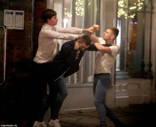 Meanwhile tension flared on the streets as two men were seen scrapping, with a man on a mobile trying to separate them