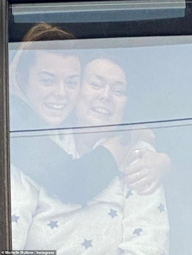 Emotional:Her final post saw her tearfully filming her friends as they sang up to her, while she watched with Liv from her bedroom window ahead of Christmas