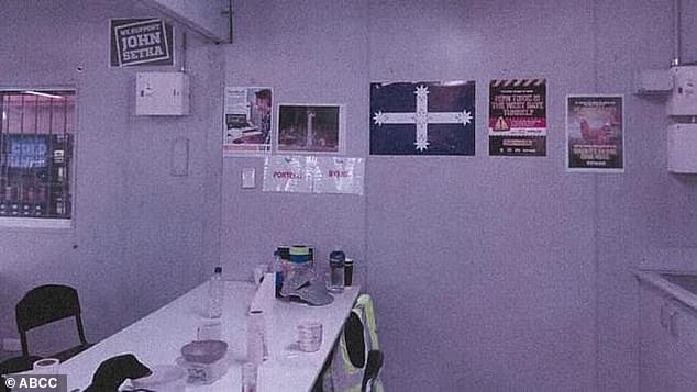 A 'We Support John Setka' poster and Eureka flag hang in a lunchroom, which the Australian Building and Construction Commission say breaches the building code