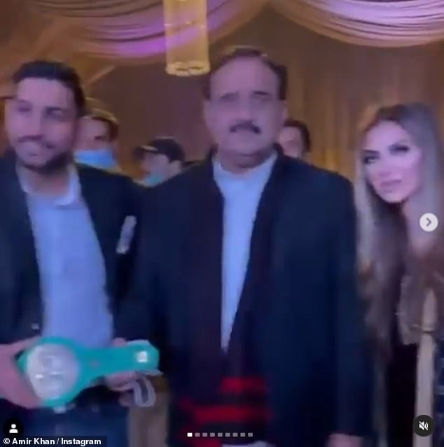 Pictured:Khan and his wifeFaryal Makhdoom posed for pictures with Usman Buzdar, Chief Minister of Punjab province, during a high-profile boxing event on 19 December that he helped organise in the country