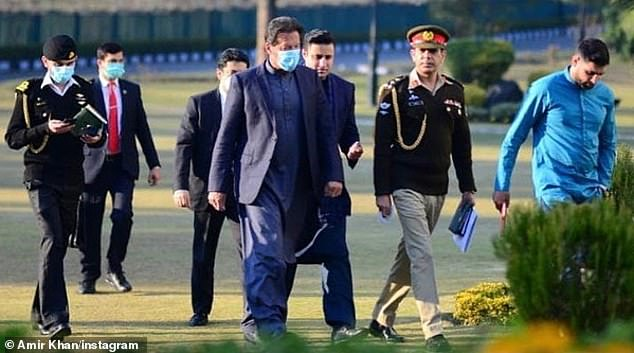 Stepping out:Just a day after Pakistani media reported it, Khan met with the country's Prime Minister Imran Khan. In one snap posted on Instagram, the boxer - far right, can be seen walking alongside the Pakistani premier and a senior military general, without a mask