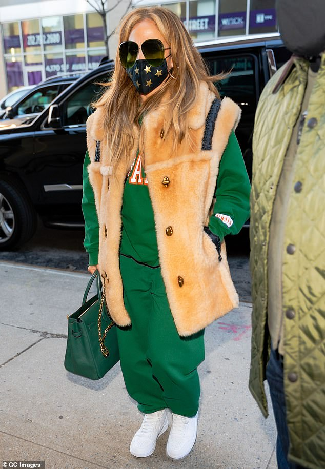 Green with envy: The 51-year-old triple-threat looked great in an emerald sweatsuit with a fuzzy vest and matching Birkin bag