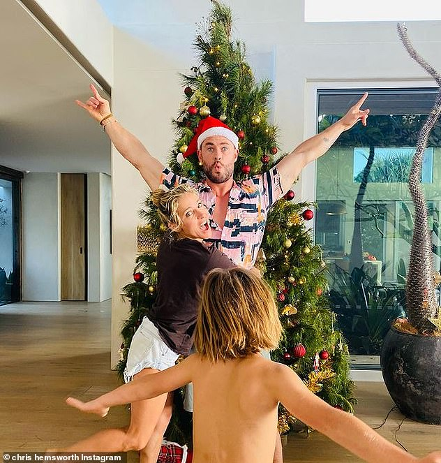 'Happy holidays!'The couple are celebrating the holidays with their children, daughter India Rose, eight, and five-year-old twin sons Tristan and Sasha