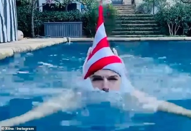 Christmas Dip: She included a video while lapsing in the pool with her husband, dipping his elf hat underwater, complete with fake white beard and ears.