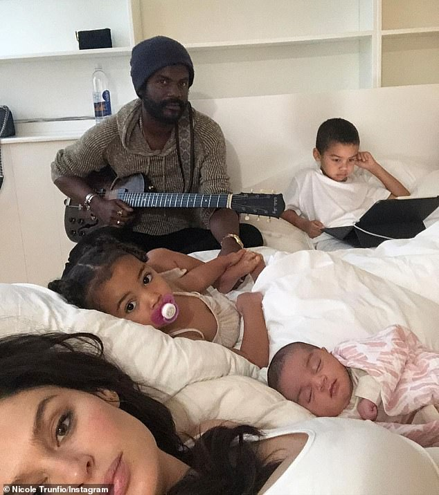 Keeping it in the family: In addition to baby Ella, Nicole and husband Gary Clark Jr. are also parents to son Zion, five, and daughter Gia, two
