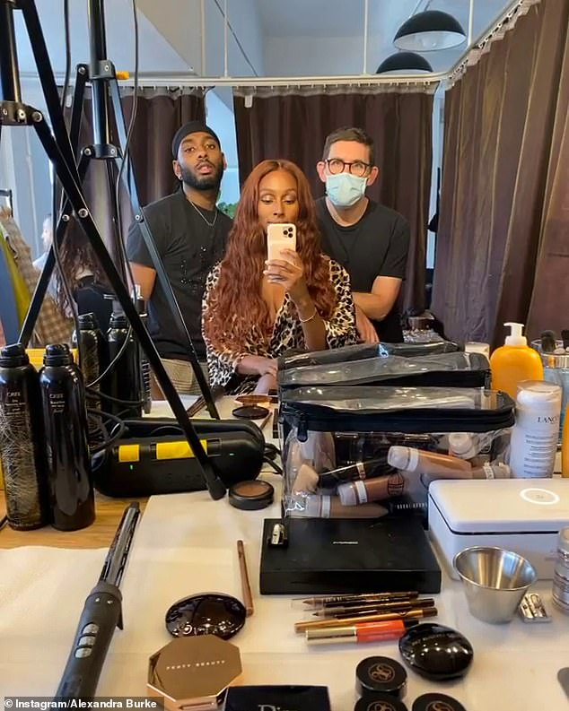Getting ready: Alexandra shared a few clips of her getting her hair and make-up ready by a team of stylists for the photshoot