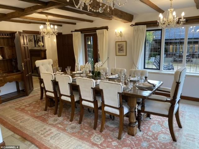 The home in Chalfont St Giles, Buckinghamshire, also features a lavish dining room that is fitted withchandeliers and wooden beams on the ceiling