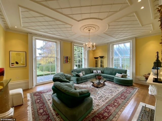 A step inside the Georgian mansion, Springfield Court, which is on the market for £2.995 million, reveals a spacious living room which offers views of the sprawling garden outside