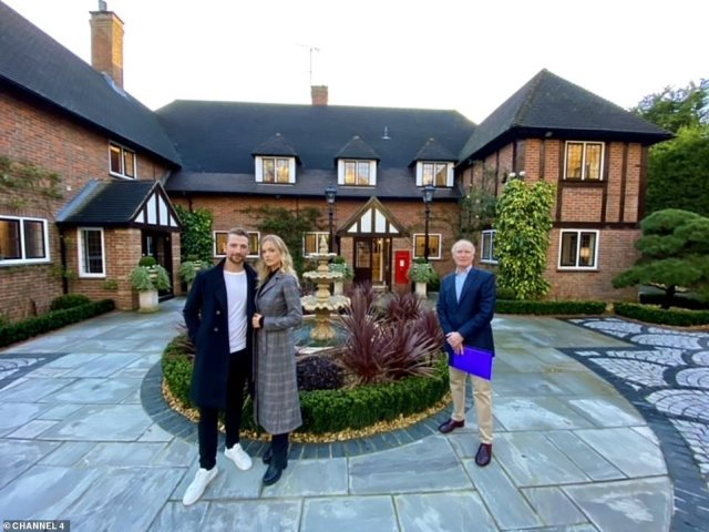 Charli and Zac also paid a visit to the £6.95 million Chalfont Manor, in Chalfont St Giles, Buckinghamshire, with the estate agent (right)
