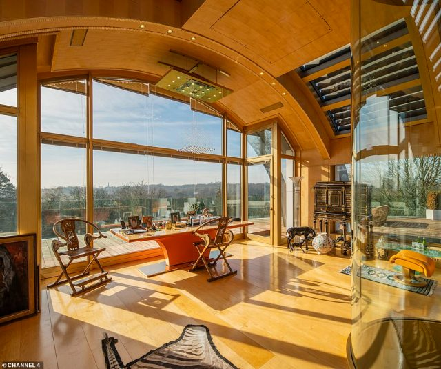 Heathfield House is topped by a glass dome with a glass lift and also comes with ten bedrooms and seven bathrooms over four floors