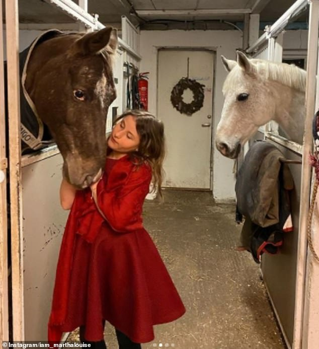 In one of the snaps, Princess Martha Louise's youngest daughter Emma, 12, could be seen stroking a horse while dressed in a festive red dress