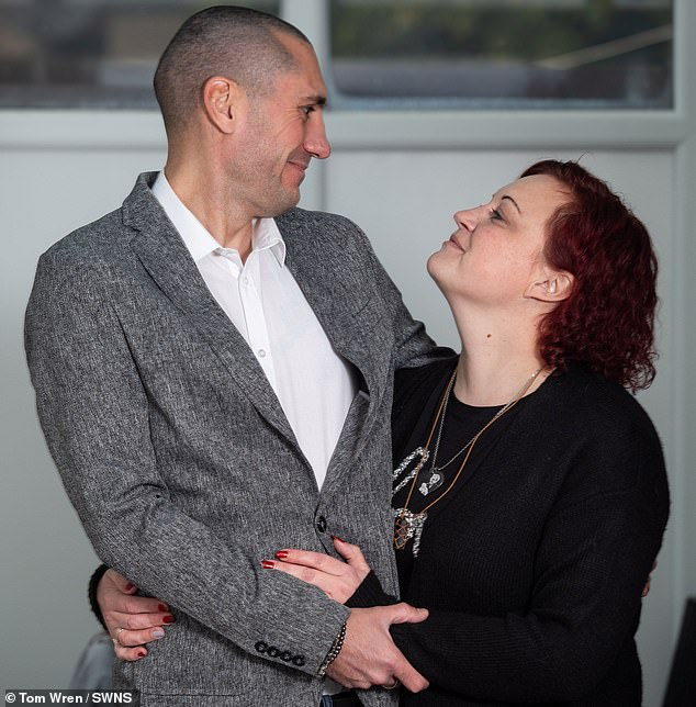 Luke Williamson (pictured with his wife Laura), 34, from Patchway, Bristol, flushed almost all the natural sodium from his body by taking on too much fluid - and it nearly proved fatal