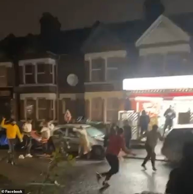 People can be heard screaming loudly as a group of men rain blows down on one another