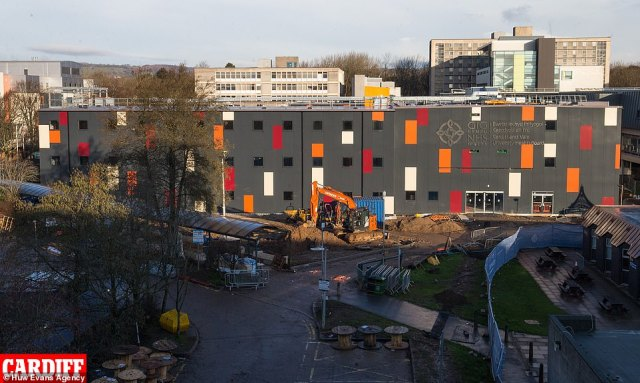 CARDIFF: Builders construct the new 400-bed surge facility at the University Hospital of Wales in Cardiff. Above is a general view of the facility pictured today