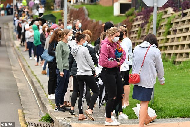 The coronavirus outbreak in Sydney has spread south to Wollongong with churches, shopping centres and an optometrist all on high alert (pictured people line up for testing in Wollongong)