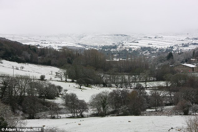 Snow covers the hills of the Peak District near Holmfirth this morning amid the festive flurries in recent days