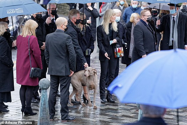 Jayne's husband, Rob, with their Weimeraner dog at St Tydfil's Old Parish Church.The couple's favourite song, Roberta Flack's 'The First Time Ever I Saw Your Face', ended the service