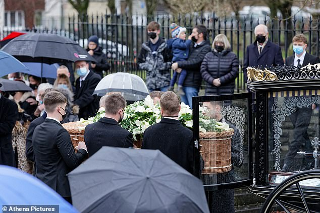 Pallbearers carry the wicker coffin in the horse drawn carriage as it arrives at St Tydfil's Old Parish Church in Wales.Jayne was described as a 'wonderful woman who truly loved life'
