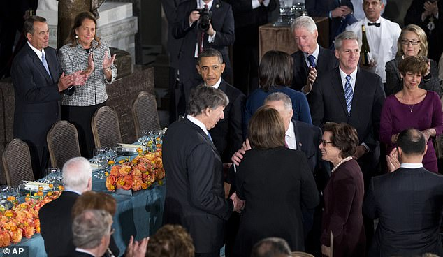 President Barack Obama arrives at his inaugural luncheon in 2013