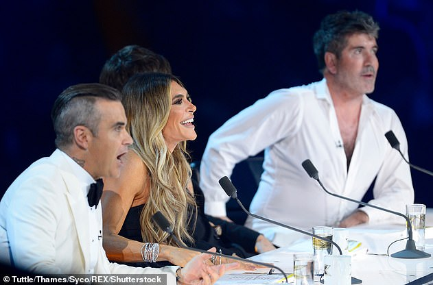 Impressive!It comes after Robbie reportedly earned £19.8 million in 2019, despite the fact he and Ayda left their lucrative role at The X Factor (pictured on the show in 2018)