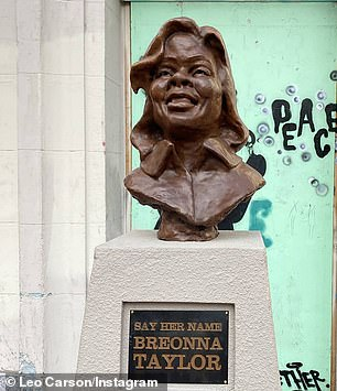 The statue is pictured prior to being vandalized