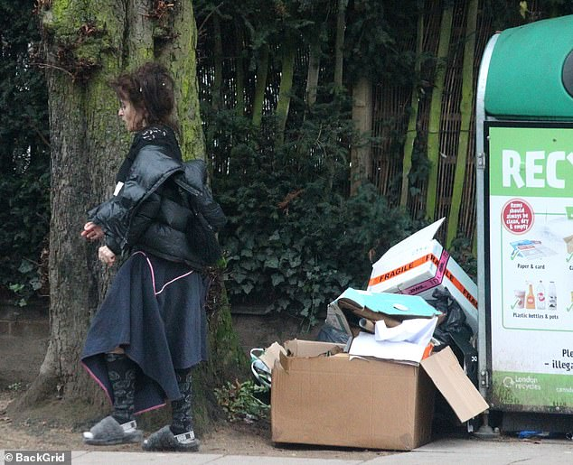 Out and about: Helena Bonham Carter cut a casual figure as she took a trip to a recycling centre in Hampstead with a friend on Monday