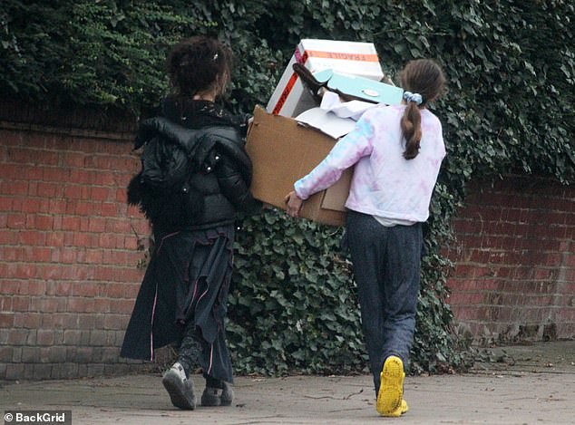 Casual: Helena also sported a pair of grey slippers on the outing as she was seen dropping off a pile of boxes