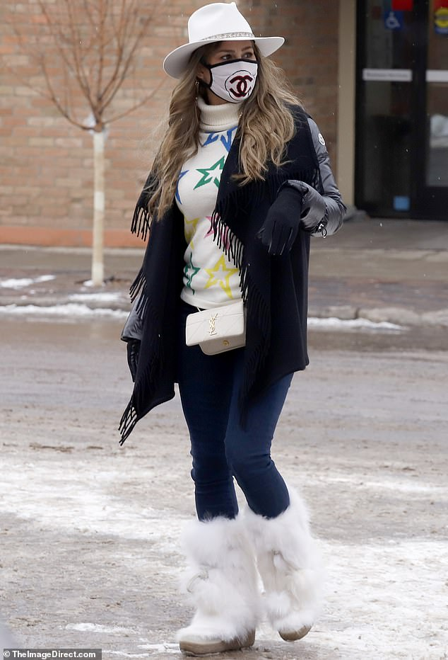 RHOC star Kelly Dodd teams Chanel mask with fur boots and cowboy hat in Aspen