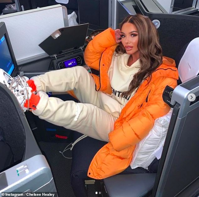 Holiday time:Chelsee had revealed she was jetting off for a festive break on Sunday with a snap of her posing up a storm on a plane