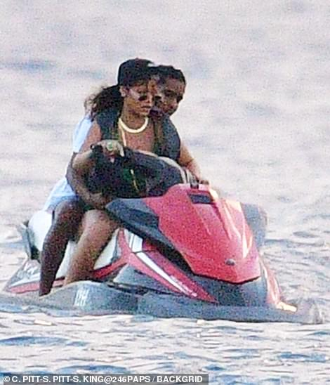 Talk that talk: Rihanna steered the watercraft as Rocky held onto her hips from behind