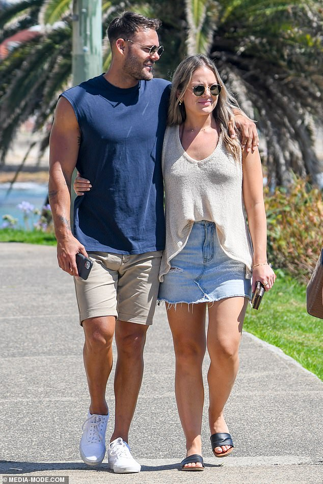 Out and proud:The former reality star proudly flaunted his new romance, putting his arm lovingly over Emily's shoulder as they enjoyed a stroll together