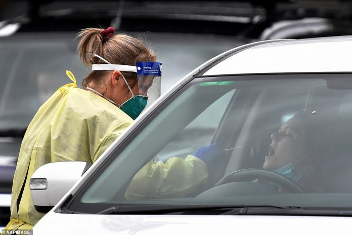 A nurse tests a patient in Wollongong on Wednesday after two mystery cases were recorded in the area. Sydney has now suffered 160 cases since 16 December
