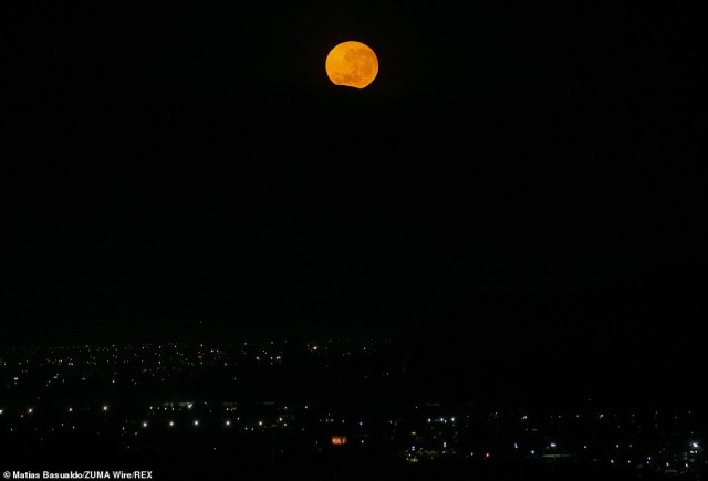 The moon was in the sky for more than 15 hours from Tuesday evening into Wednesday morning, making it the longest full moon of the year.The moon is seen setting behind a hill on the morning of December 29 in Chile