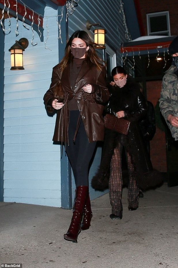 Come here girls!  Leading the way, the 25-year-old supermodel was honored in a stunning brown look while her cosmetic mogul sister, 23, and mom, a 64-year-old momager, went for the elegant black coat, while Chris' boyfriend Corey Gamble was in hot pursuit.
