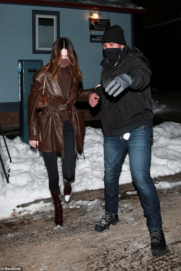Helping Hand: A colleague guides Kendall to their waiting car