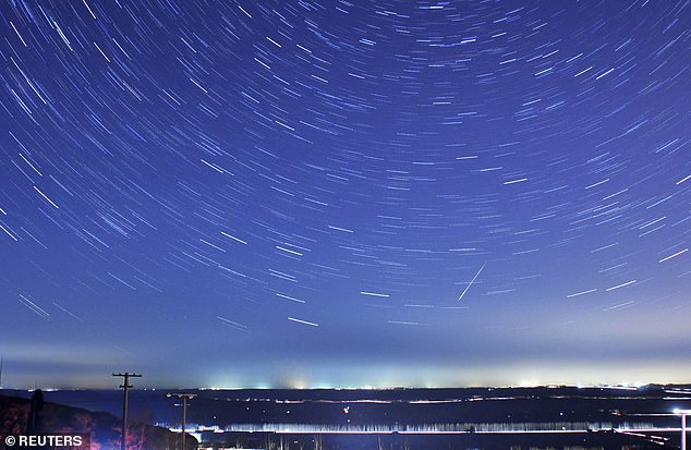 A meteor streaks past stars during the annual Quadrantid meteor shower in Qingdao, Shandong province, January 4, 2014