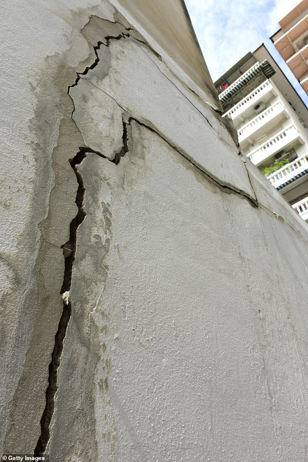Subsidence is usually caused by the removal of local groundwater — and can be triggered by dry spells, the roots of trees and shrubs and human activities. Pictured, subsidence beneath a concrete residential building in southeast Asia has lead to structural damage
