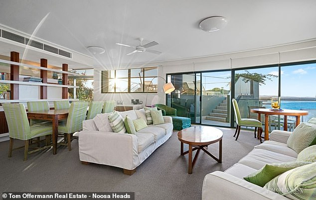 The living rooms (pictured above) offers breathtaking views of Noosa Main Beach and out to the Coral Sea