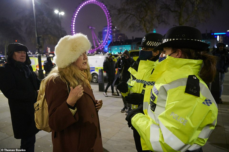 The banks of the River Thames would usually be packed for the New Year's Eve fireworks display, instead police were forced disperse revellers last night amid Covid-19 restrictions