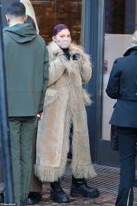 Kylie Jenner stays warm in a furry coat as she and sister Kendall go shopping in Aspen