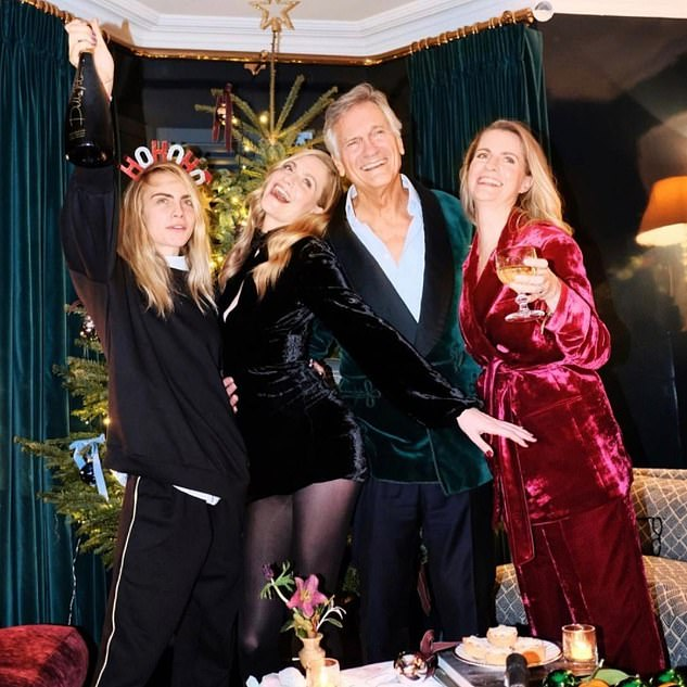 Charles and his wife Pandora, who have homes in Tier 4 London and Sussex, hosted the party, which is understood to have been attended by Chloe, her sister Poppy and their families, as well as LA-based Cara and her grandmother, Jane Stevens. The only picture posted online by Cara was taken at Poppy's West London home weeks before Christmas. Cara said she was celebrating 'with the fam'. (Above, Cara, Poppy and their parents)