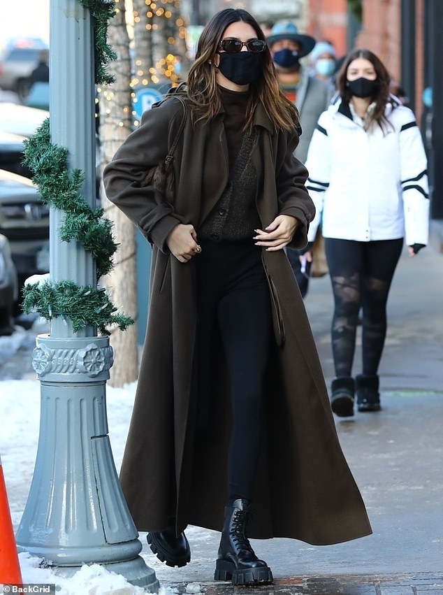 Toasty:She had on layers underneath with a buttoned-up gray cardigan and a brown mock turtleneck, along with high-waisted black leggings
