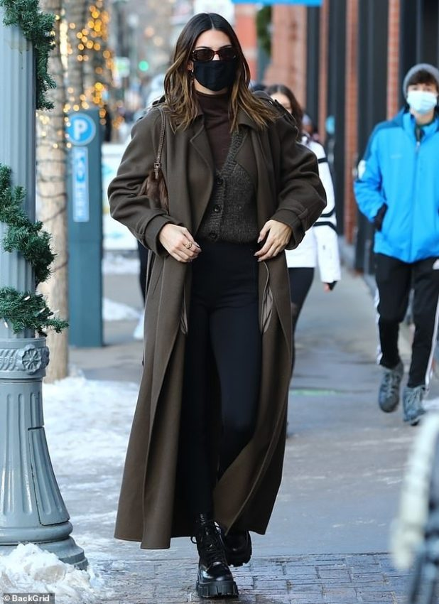 Chic: Kendall looked stylish in a more reserved brown overcoat that increased her size by 5 feet 10