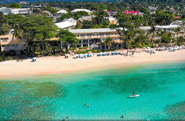 The pair were instructed to remain at their £300-a-night Sugar Bay resort hotel (pictured) after the model's partner tested positive for the virus