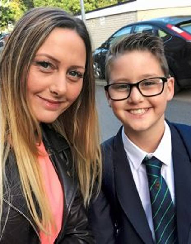 Jo Wood with Harley, smiling in his smart uniform shortly after starting at Debden Park High