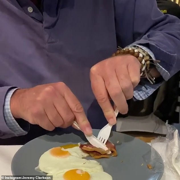 Forkward: The presenter was filmed attempting to cut into a piece of bacon as he enjoyed a fry-up with co-host James May during a break from filming The Grand Tour in Scotland