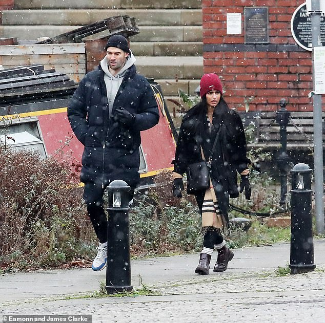 Wrapped up: Coronation Street actress Sair Khan stepped out for a New Year's stroll on Saturday afternoon in Castlefield, Manchester. Accompanying her was a mystery male companion
