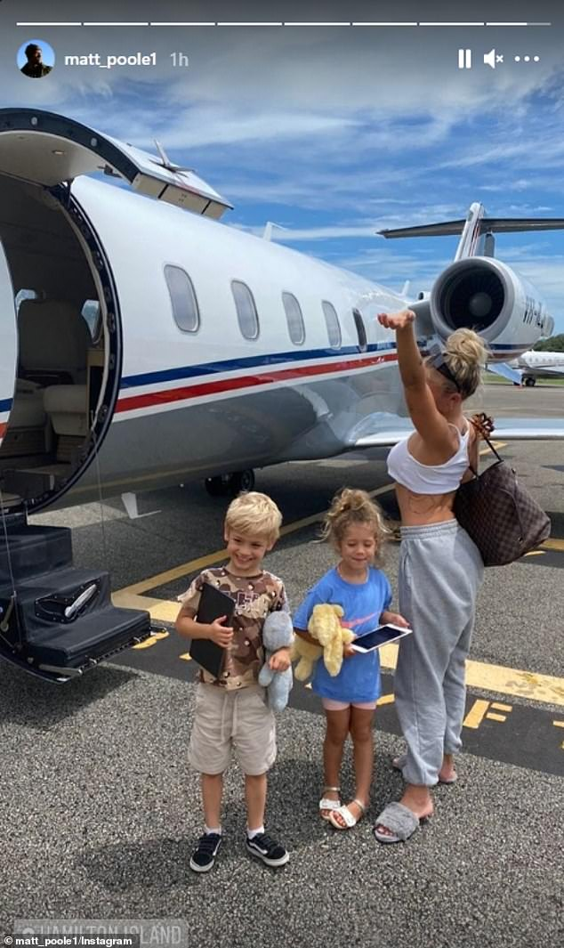 Time for a break: Upon landing, Matt shared a photo of Tammy and her two children - Wolf (left), five, and Saskia (centre), three - on the tarmac and tagged 'Hamilton Island'