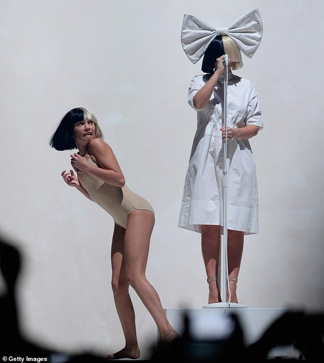 Comments: 'I realised it wasn't ableism, I mean it is ableism I guess as well, but it's actually nepotism because I can't do a project without her,' the Australian singer, 45, explained. Sia and Maddie are pictured together on tour in Las Vegas in 2016